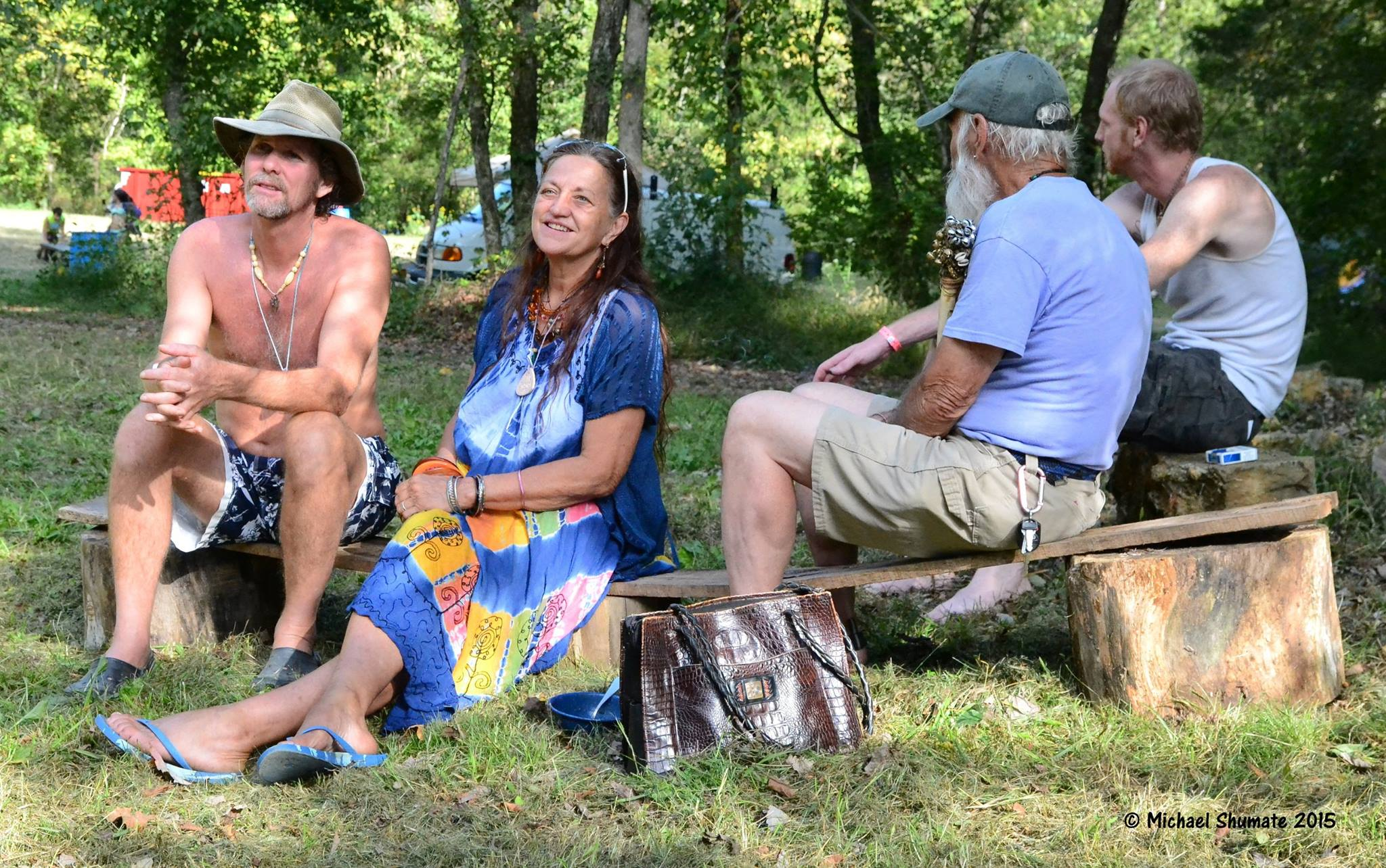 hippies at music festival 2015 by michael shumate
