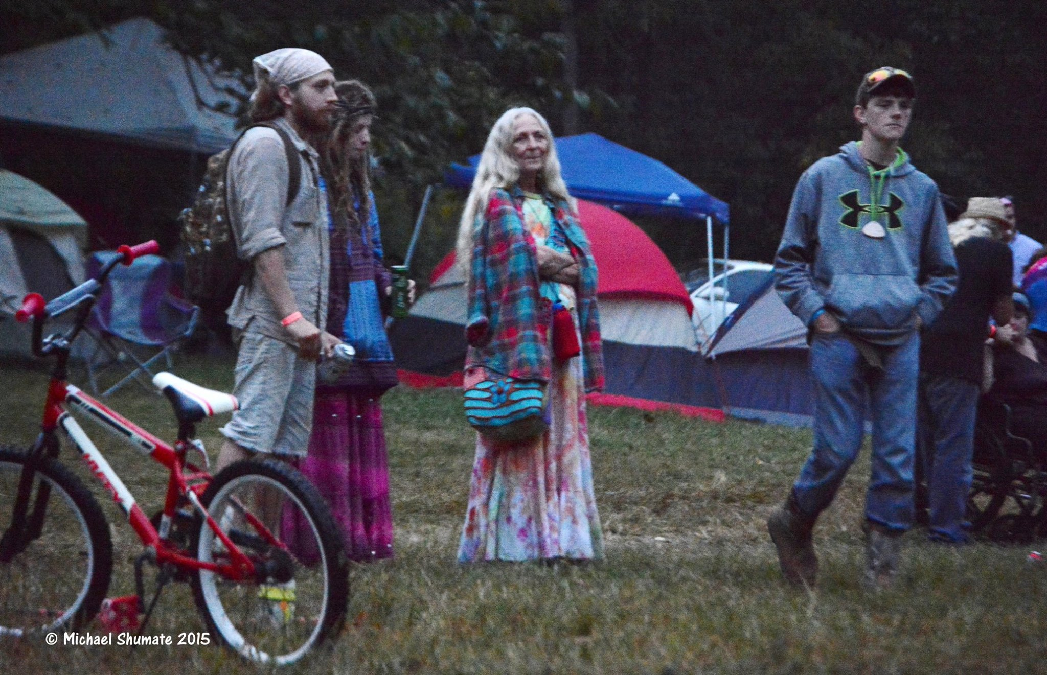 hippies at music festival by michael shumate fe 2015